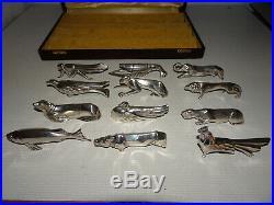 12 portes-couteaux ART DECO en métal argenté. Sandoz. En coffret