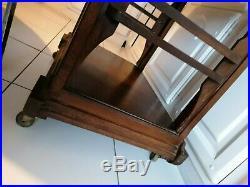 Belle Table, console ancienne design Art Deco en bois sur roulettes à voir
