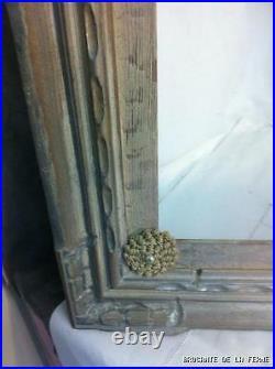 Cadre sculpté en bois époque Art déco patiné avec passementerie