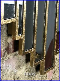 Glace / miroir Miami de style Art déco en bois doré patiné