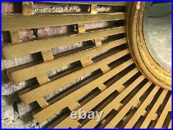 Glace / miroir soleil style art déco en bois sculpté doré Diam. 124 cm 80'S