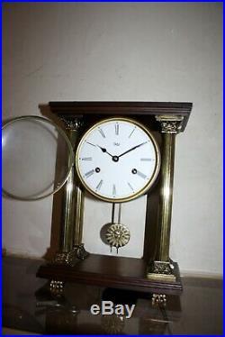 Pendule à colonne ODO, balancier, clock bronze et bois