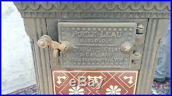 Poêle a bois leau 1920 1930 en fônte Art deco