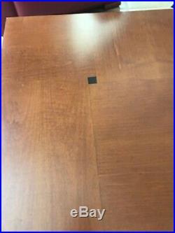 Table basse Hugues Chevalier modèle Lausanne en bois vernis mat